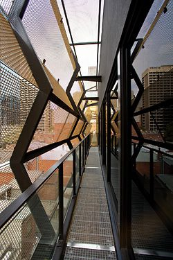 """The facade of the two-storey addition to 103–105 Lonsdale Street, Melbourne, by SJB Architects. The light, transparent mesh facade was designed to read as a """"lantern"""" hovering over the heritage-listed building. Image: Jesse Spezza."""