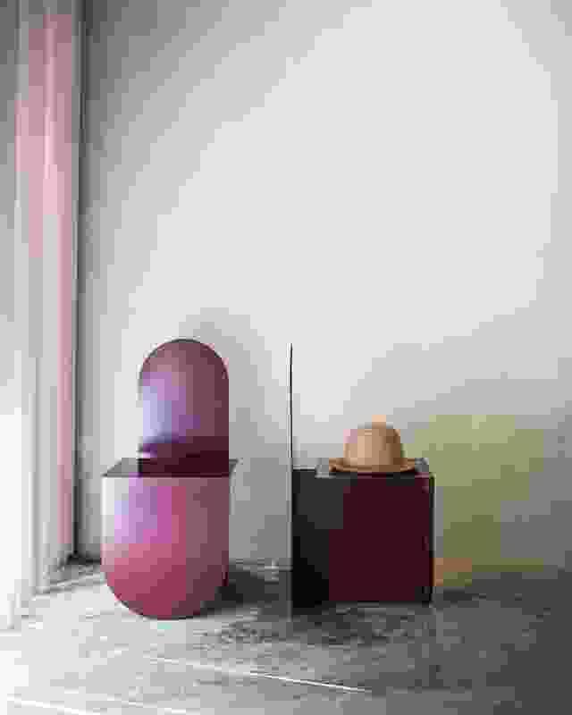Blush vertical blinds temper natural light and cast spliced light shards across the concrete floor.