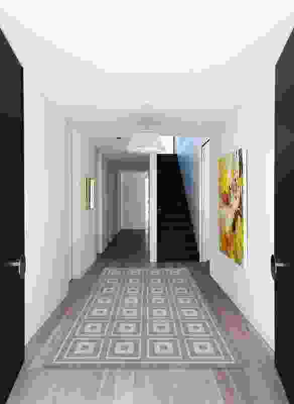 A hallway splits the ground level. Artwork: Jo Davenport, Pressed Between Yellow.