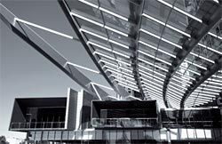 The glazed canopy of the Q1 podium, with conference blocks projecting below.Image: Russell Shakespeare