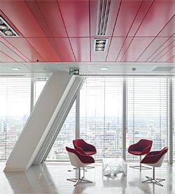 Metal ceiling system finished in three different shades of red.