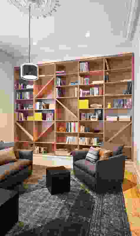 A custom-designed bookshelf in one of the original rooms.
