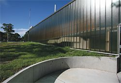 The circular concrete entry patio at the north-west corner of the building.