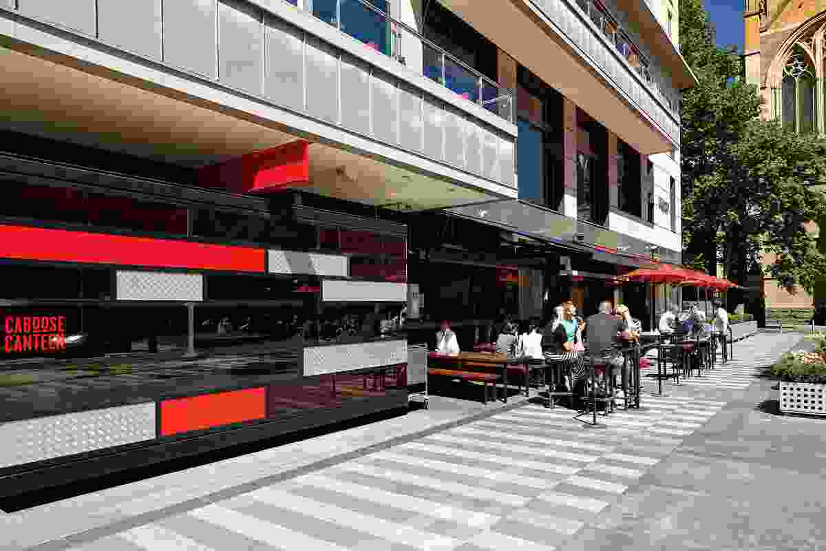 Bars and shops now edge the open space.