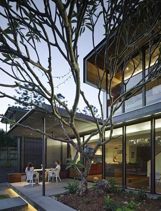 The design extends the main living area into the subtropical garden surrounds.