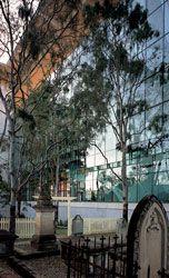 The glazed elevation adjacent to the cemetery includes Jill Kinnear's artworkThe Veil.
