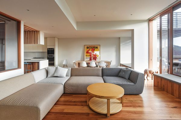 The neutral colour palette used on the interior surfaces draws attention to colourful or tactile elements, such as a painting or view outside.