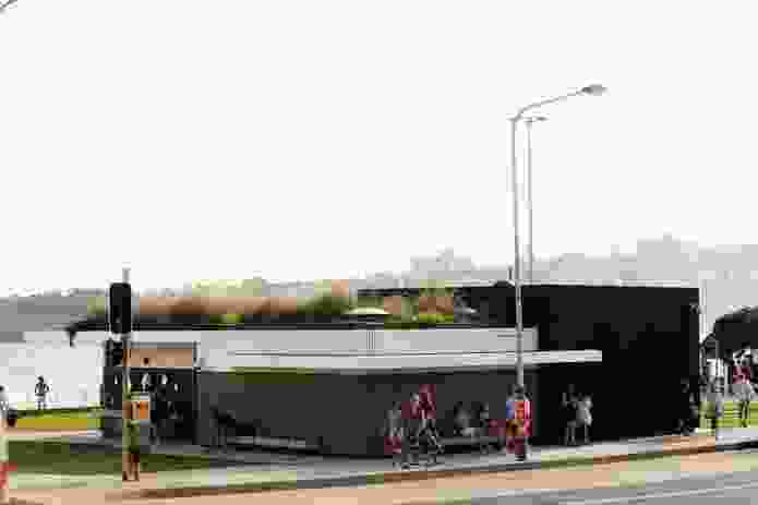 "The north-eastern corner of the building doubles as a bus shelter, while the green roof acts as a ""fifth facade"" for the tall overlooking neighbours."