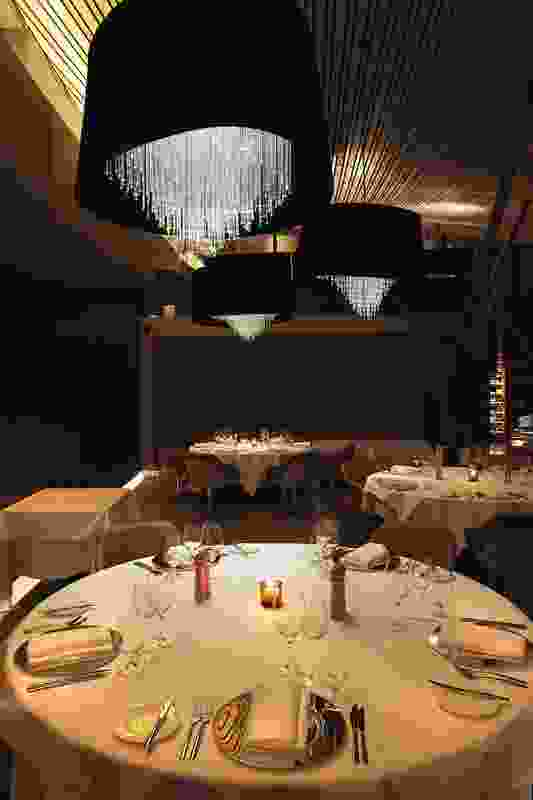 Chandeliers by Judith Abell of Futago in the dining room.