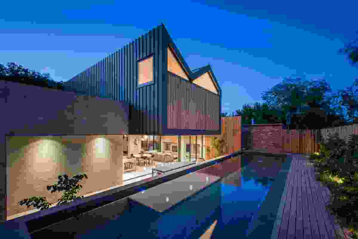 The project is a new blackened steel- and timber-clad extension to a double fronted cottage.