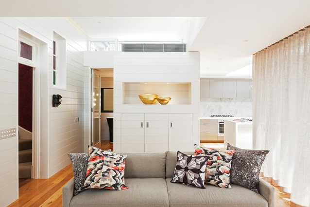 """The """"elbow"""" of the L-shaped house plan is used to conceal a couple of bathrooms."""
