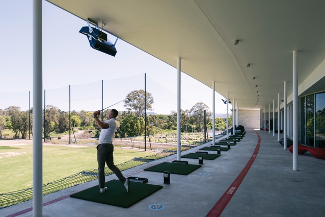 "Forty sheltered golf driving bays are housed within the main building's ""necessarily curved"" south-western facade."