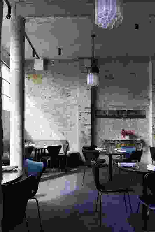 In the back third of the restaurant, a large window has been cut into the rear brick wall, bathing the room in northern sun.