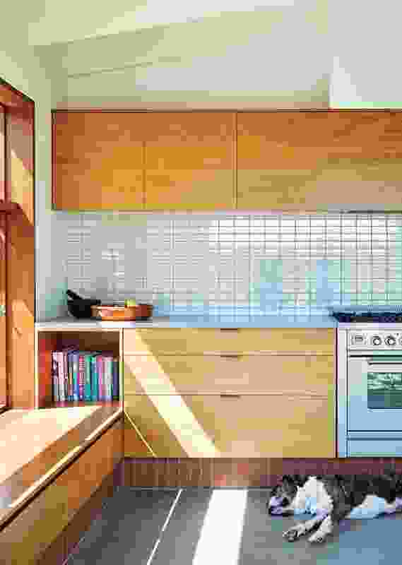 """The focus of """"a very economical diagram,"""" the new kitchen judiciously joins with the body of the cottage."""
