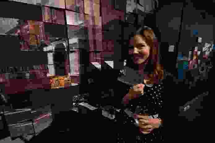 Lucy Fuchsbichler choosing a postcard of Home?.