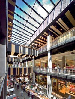 The new interior 'shopping street' allows shoppers to easily navigate the complex while bringing daylight in and allowing glimpses of the outside world.