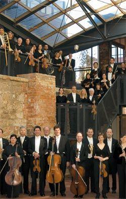 The Tasmanian Symphony Orchestra pose in the atrium.