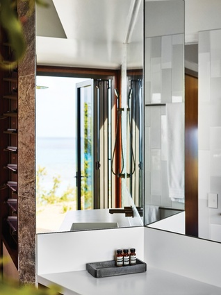 Mirrored surfaces are used to retain a connection with the outdoors, but also to give the impression of generous space.