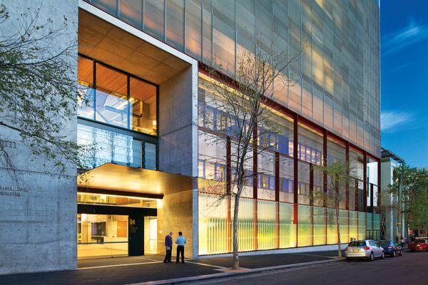 The facade, like the building, is a layering of transparency and security.