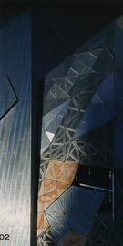Detail of the west facade of the ACMI, with stone cladding meeting aluminium.Image: Trevor Mein.