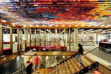 At QUT Kelvin Grove Library, a ceiling made of hundreds of old book covers adds drama to the staircase.