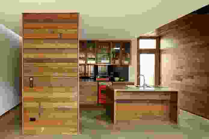Recycled hardwood is used in the kitchen, with modest fittings and appliances to reduce environmental impact.