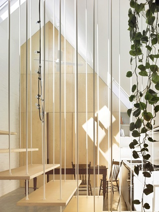 The suspended stair had to be permeable to light from the skylights and rear elevation.