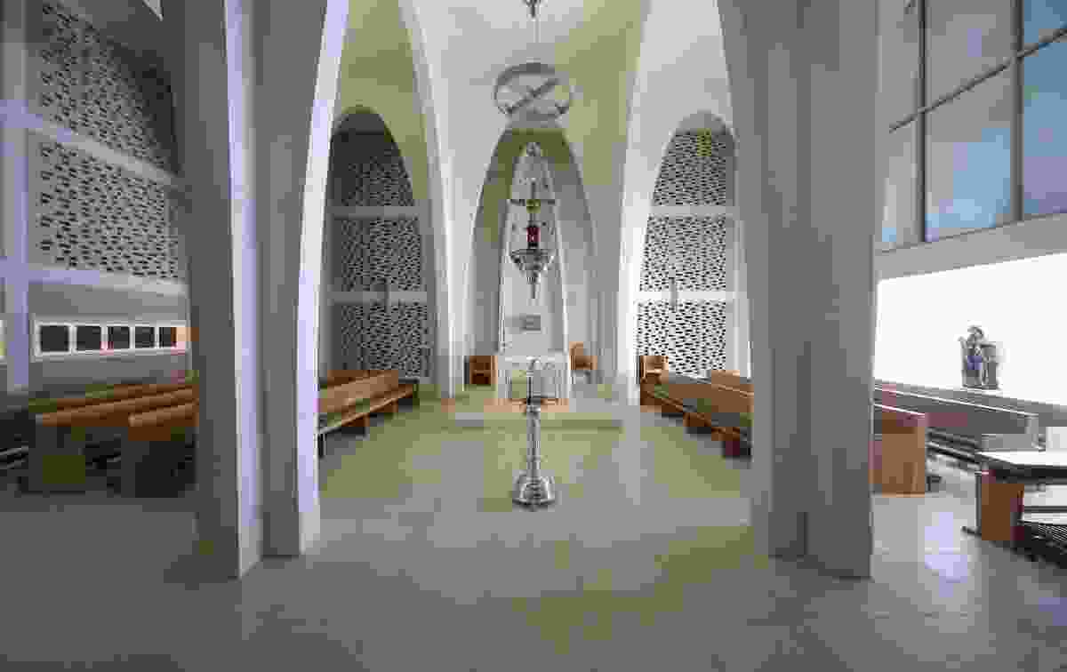 The perpendicular alignment of the pews and the entry and alter creates an intimate space.