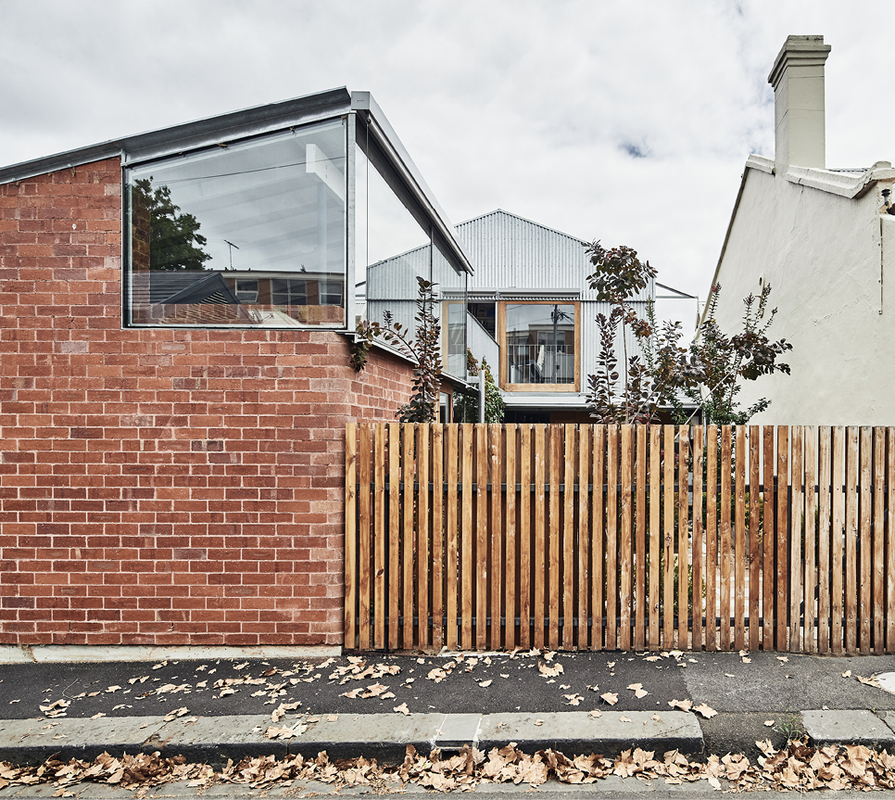 The silhouette of the exterior is reminiscent of lean-to extensions typical of corner terrace houses.