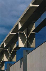 "Precast concrete ""T""-shaped sunshades hang from the top of the building. Image Trevor Mein"