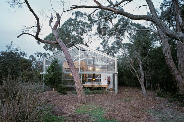 The house is pared down to the barest of essentials: an off-the-shelf steel shed kit with polycarbonate cladding, three large facade walls, a raised deck, timber mezzanine and plumbing.