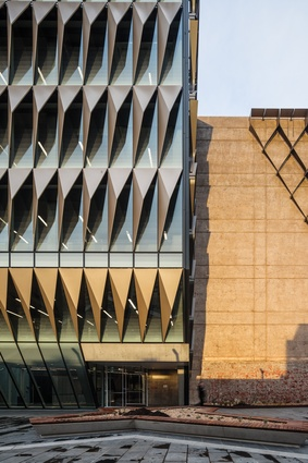 """Driven by cost and sustainability concerns, the decision to retain the existing buildings allowed the architects to play with a retro aesthetic, with an exposed brick wall facing Ryrie Street showing the """"layers of history."""""""