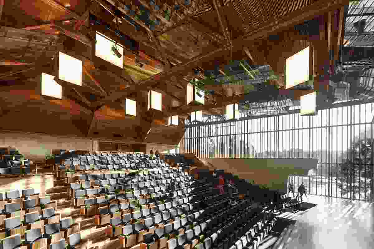 The 500-seat lecture theatre, with a roof of exposed timber trusses.