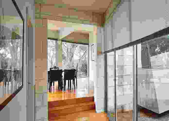 While the kitchen looks inward, the dining space is close to the windows and offers access to a wedge-shaped deck