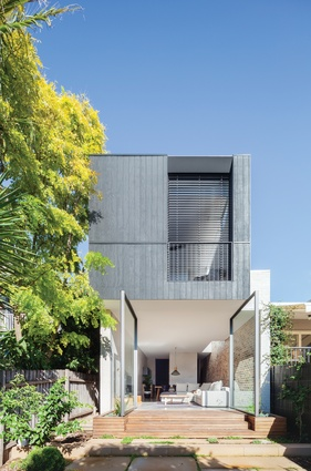 The rear elevation is simple in form and balances privacy with openness.