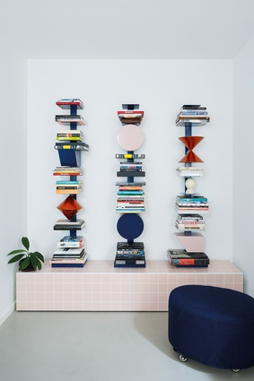 """Throughout the interior, """"totems"""" contain valued objects such as books."""