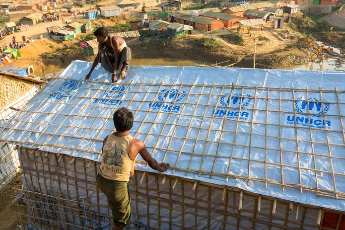 Rohingya refugees constructing housing in Bangladesh.