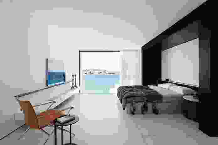 The main bedroom faces the beach and is separated from the dressing room by an ensuite.