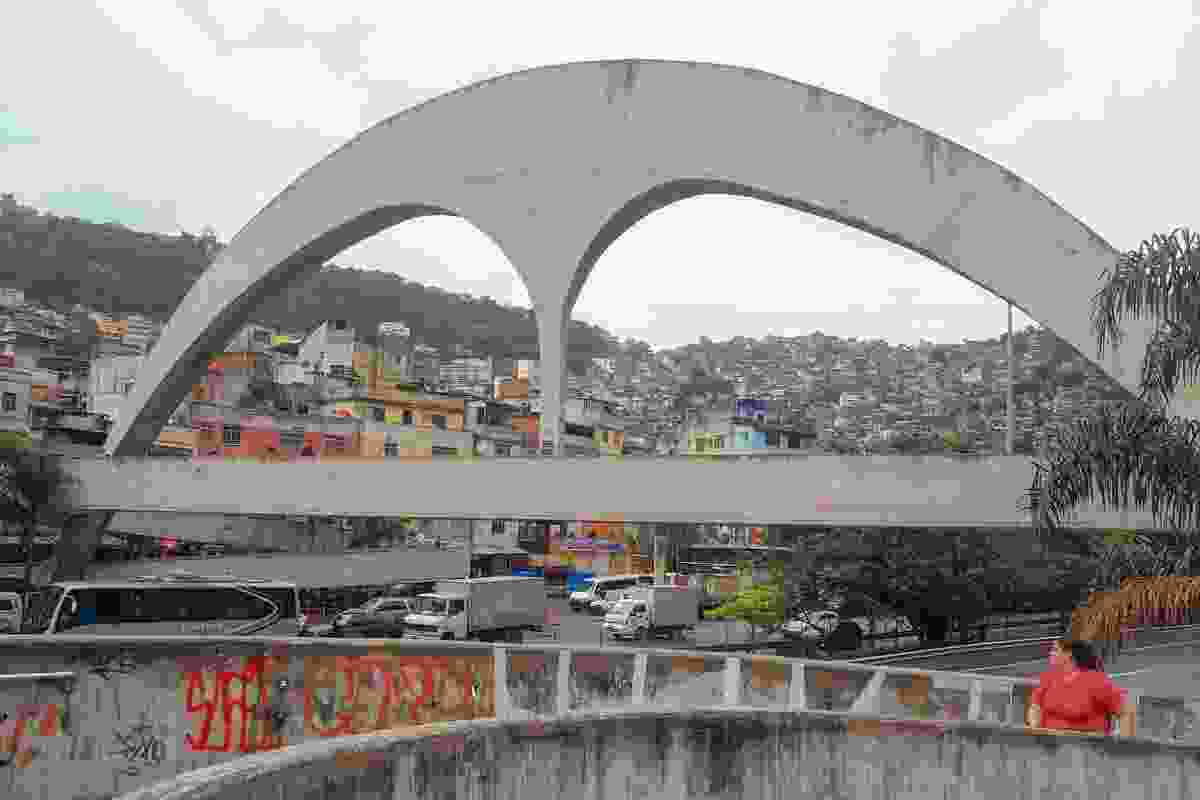 A sweeping concrete footbridge designed by Oscar Niemeyer marks the entry to Rocinha.