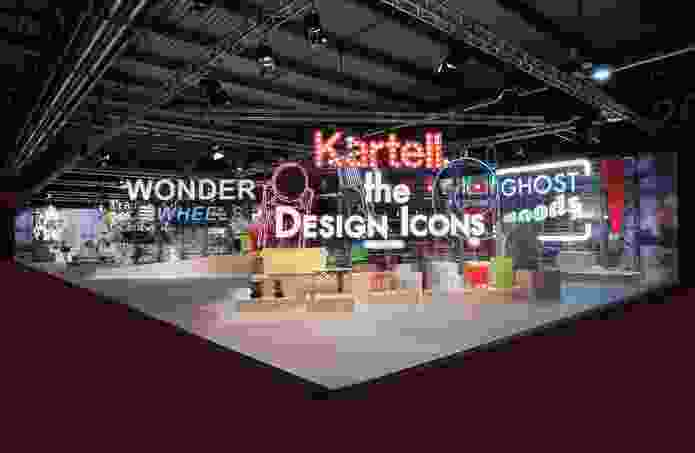 The Kartell stand at the fair teamed timber and neon lighting.