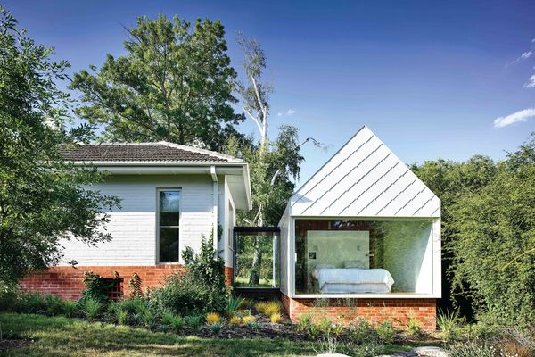 Wrapped in hand- fixed shingles and set on recycled brick plinths, the contemporary pavilions are discrete yet sympathetic to the older home's character.
