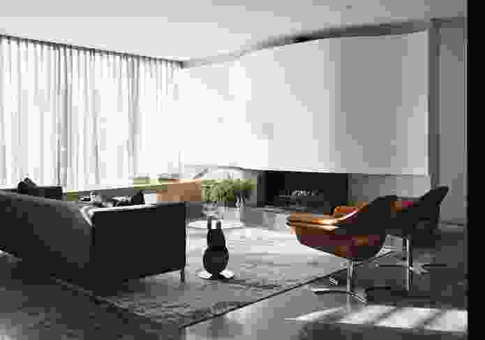 The curved hard-plaster-on-moulded-ply fireplace surround in the sitting room is a clear nod to Alvar Aalto.
