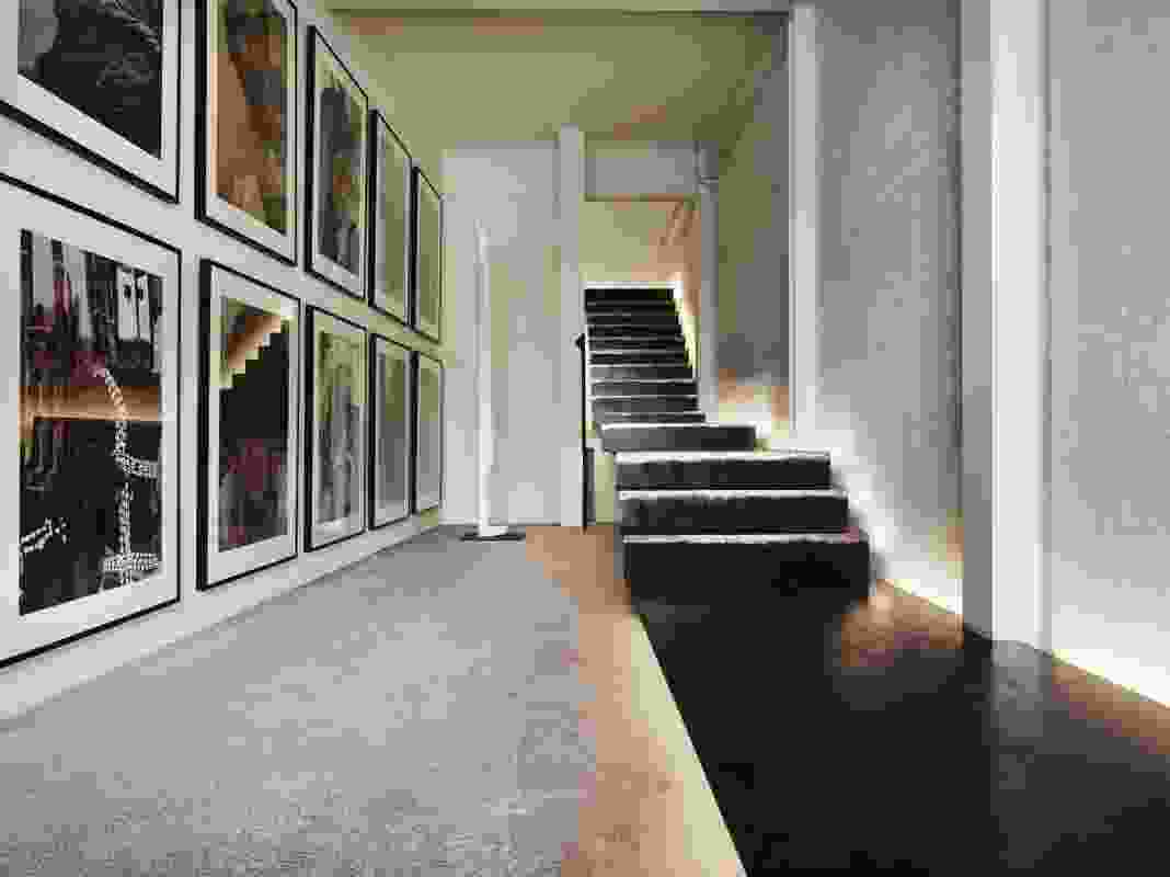 The stairwell forming the entry to the residence on the upper levels.
