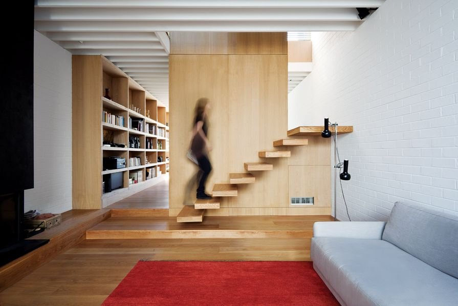 The lounge room features a stair with no balustrade.
