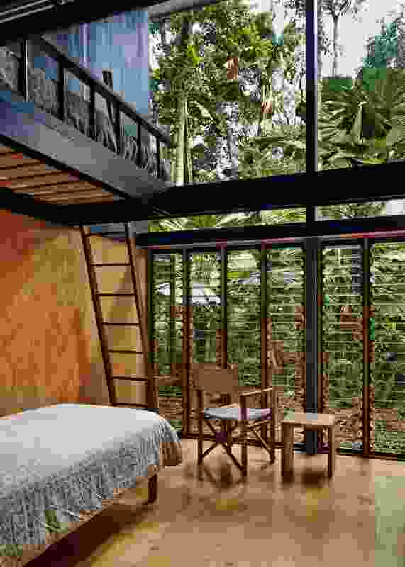 The bedroom's double-height volume addresses the scale of the forest while easily accommodating bunk beds.