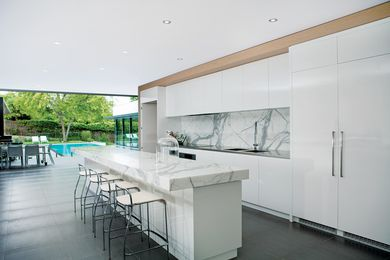The kitchen flows seamlessly to outdoor entertaining areas.