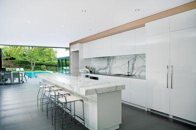 The kitchen flows seamlessly to outdoor entertaining areas.