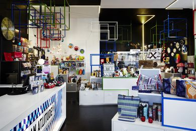 The interior relies on contrast and its Tetris-inspired fittings to highlight store displays.