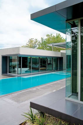 Three new pavilions surround a courtyard; a garage is under the pool.