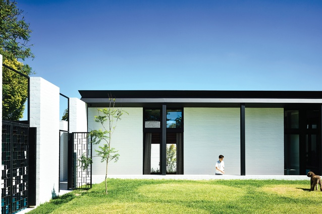 A central garden area, protected by the house's L-shaped plan, offers ample space for play.